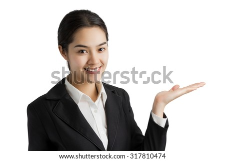 Young Asian business woman in black suit open palm hand for show something isolated on white.