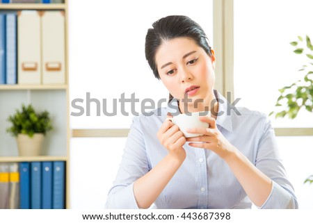 Young asian business woman overworked with uncomfortable in office