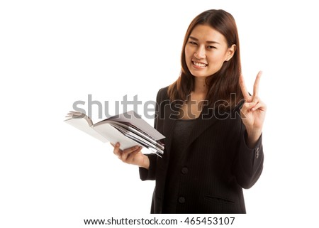 Young Asian business woman show victor sign with a book  isolated on white background.
