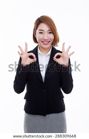 Young Asian business woman showing okay sign isolated on white background.  - stock photo