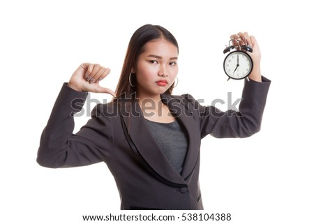 Young Asian business woman thumbs down with a clock  isolated on white background.