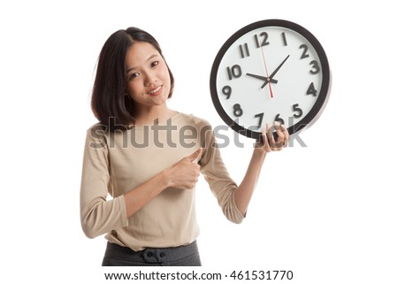 Young Asian business woman thumbs up with a clock  isolated on white background .