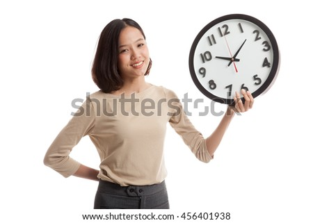 Young Asian business woman with a clock isolated on white background