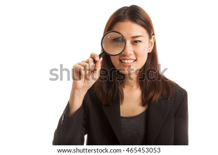 Young Asian business woman with a magnifying glass  isolated on white background.