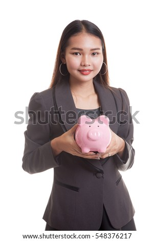 Young Asian business woman with a pig coin bank  isolated on white background.