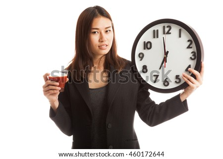 Young Asian business woman with tomato juice and clock  isolated on white background.