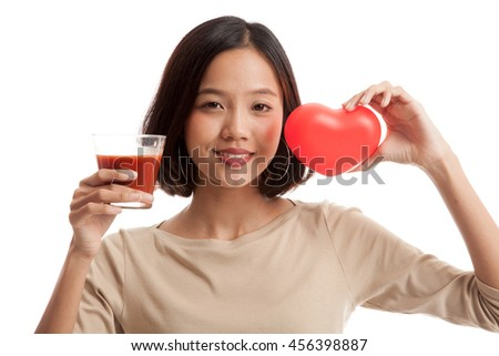 Young Asian business woman with tomato juice and red heart  isolated on white background