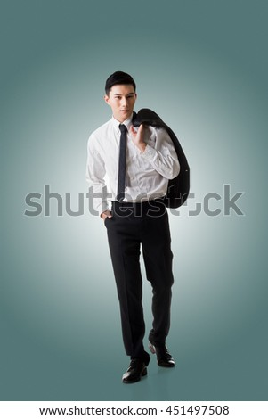 Young Asian businessman hold coat and go off work, full length portrait isolated - stock photo
