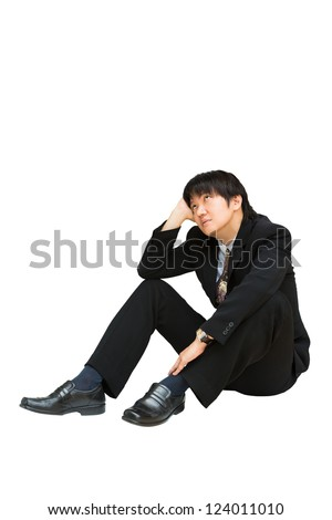 Young asian businessman sitting and looking up above his head, Isolated over white with clipping path