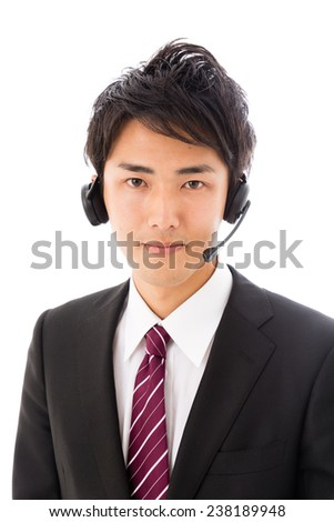young asian businessman with headset on white background