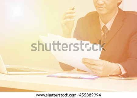 Young asian businessman working in an office.