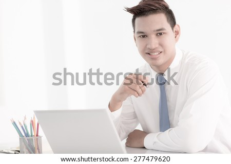 young asian businessman working in office