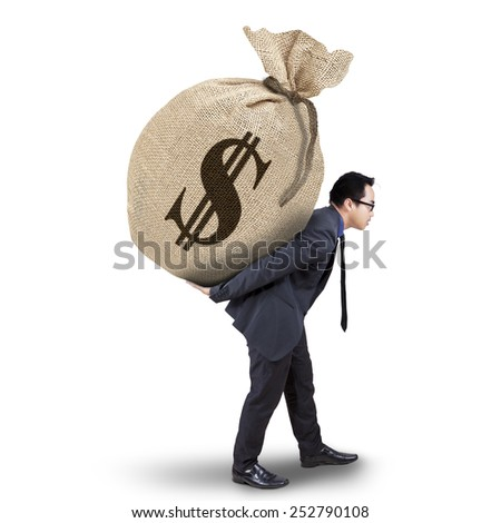 Young asian businessperson carrying a full money sack with dollar currency symbol, isolated white background - stock photo