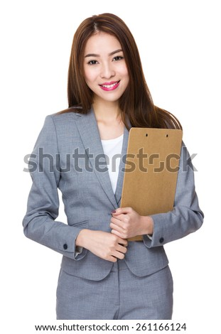 Young Asian businesswoman hold with clipboard - stock photo