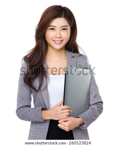Young asian businesswoman hold with notebook computer - stock photo