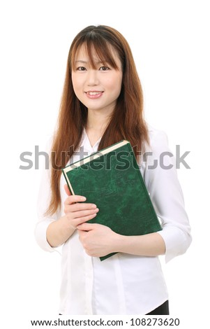 Young asian businesswoman holding a book - stock photo