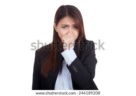 Young Asian businesswoman holding her nose because of a bad smell  isolated on white background - stock photo