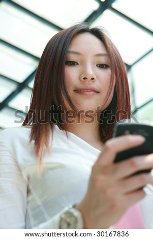young asian businesswoman holding mobile phone