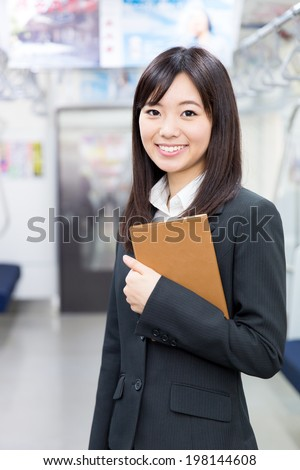 young asian businesswoman in the train