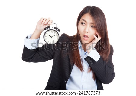 Young Asian businesswoman shock with alarm clock  isolated on white background