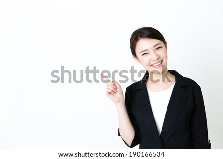 young asian businesswoman showing on white background - stock photo