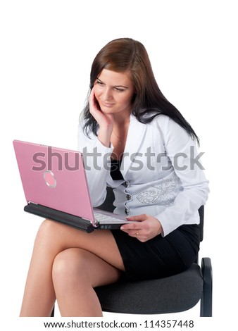 Young asian businesswoman sitting on her chair with laptop isolated on white