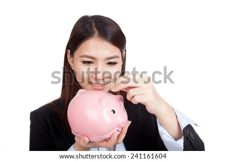 Young Asian businesswoman with a coin and piggy bank  isolated on white background - stock photo