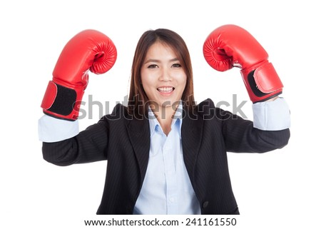 Young Asian businesswoman with boxing glove  isolated on white background