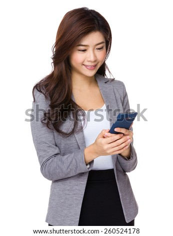 Young asian businesswoman with mobile phone - stock photo