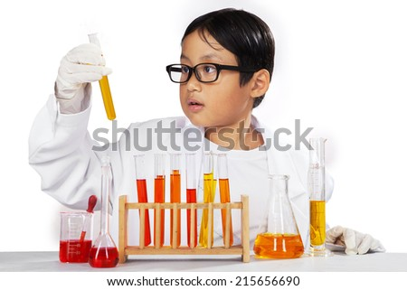 Young asian chemist holding chemistry fluid on a beaker, isolated on white - stock photo