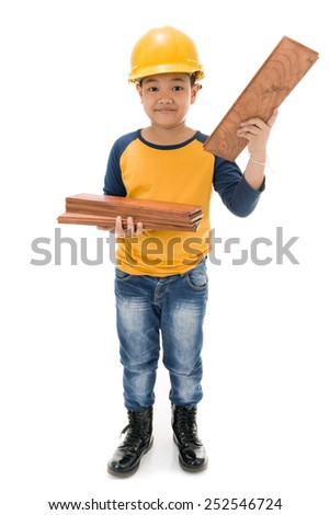 Young asian child construction Worker Holding equipment isolated on white background