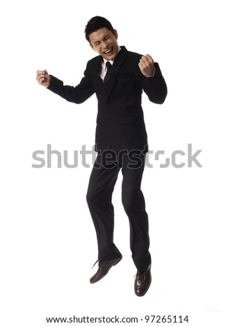 Young Asian Corporate Man jumping with fist pump over white background