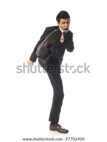 Young Asian Corporate Man kicking angrily - stock photo
