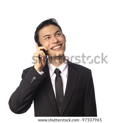 Young Asian Corporate Man Smiling over the phone against White Background