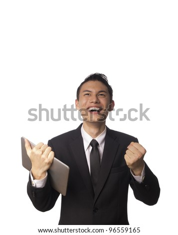 Young Asian Corporate Man with Tablet PC and Clenching his Fists Over white Background