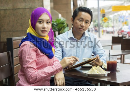 Young Asian Couple at the Cafe
