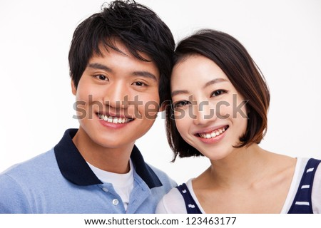 Young Asian couple close up shot isolated on white background.