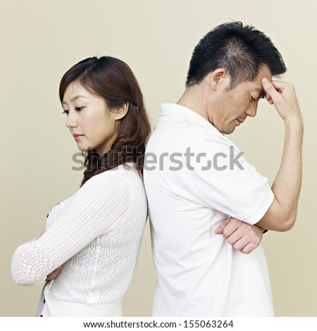 young asian couple having relationship difficulties. - stock photo