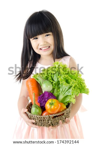 Young asian cute girl with vegetable on white background .  - stock photo