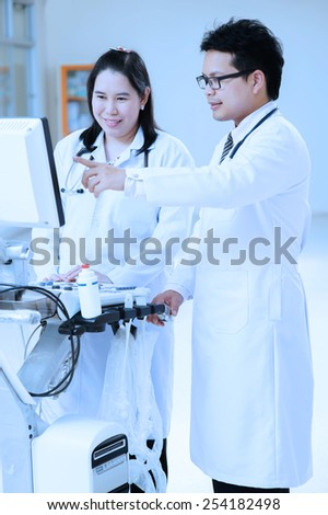 young asian doctor portrait take with blue filter - stock photo