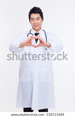 Young Asian doctor shwoing heart shape isolated on white background.