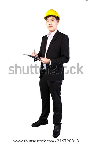 Young asian engineer architect doing a report on white background (with clipping path)