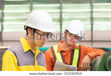 Young asian engineering in workshop,Bangkok Thailand - stock photo