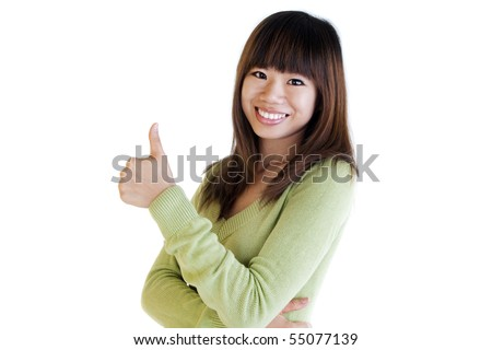 Young Asian female giving thumbs up sign. - stock photo