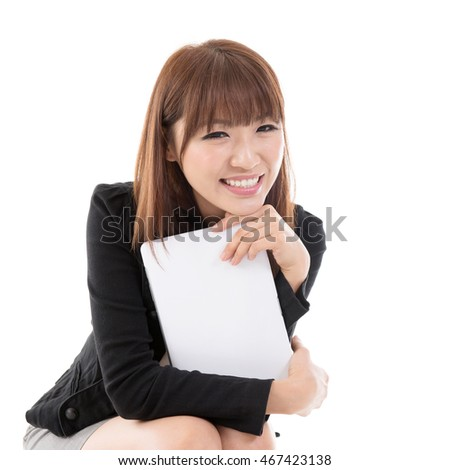 Young Asian female holding digital computer tablet and smiling, isolated on white background.