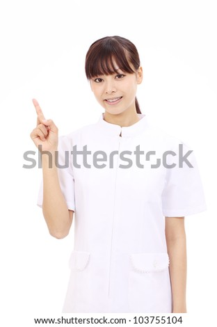 Young asian female nurse pointing - stock photo