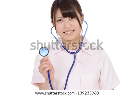 Young asian female nurse showing stethoscope