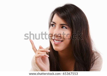 Young Asian female pointing her finger to empty space