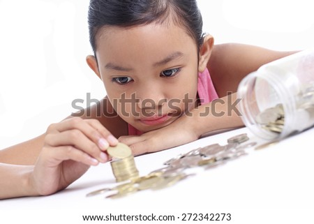 Young asian girl counting some money.