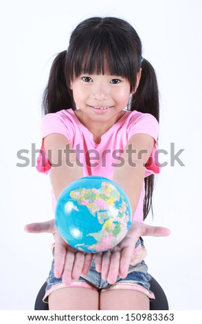 Young asian girl holding earth globe